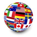 Travel, services and international business management concept with a globe and international flags of the world on white background.